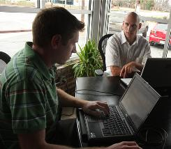 Greenville, S.C.-based Internet entrepreneurs, including Jim Ciallella, left, and Jonathan Shanin, are raising money online for a group trying to build a hospital boat in Peru.