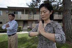 David Dongwei and his wife Lou Hongwei, Falun Gong practitioners, outside their Rowland Heights, Calif., home.