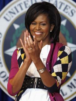 "Michelle Obama, seen here Thursday at a swearing in, told kids Thursday that she has ""the best job in the White House."""