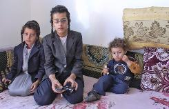 At home in Raydah, Yemen, from left, Daniel, 7, Sason, 12, and Youssef, 3, are among nine children of Moshe Yaish Youssef Nahari, a Jewish man who was shot dead by a Muslim man in December.