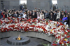 Armenians gather to  mark the 94th anniversary of the mass killing of the Armenian people, at a monument in Yerevan Friday.