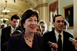 Sen. Susan Collins, R-Maine, works her way through reporters to the Senate floor during deliberations on the economic stimulus bill in February.