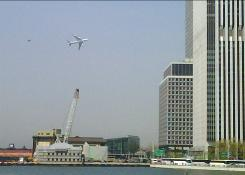 In this image taken with a cellphone by Jason McLane, a Boeing 747 flies low over New York Harbor followed by an F-16 chase plane during a federal government photo op Monday.