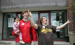 In Iowa City, Brenda Linley, right, celebrates April 27 after applying for a marriage license with partner Jodi Linley and their 18-month-old daughter, Norah.