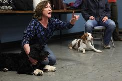 Dawn Sylvia-Stasiewicz holds Kennedy's dog Cappy as she instructs people gathered for a dog-training class at the Boys & Girls Club in Washington, D.C. Sylvia-Stasiewicz trained Bo, the new dog in the Obama White House.