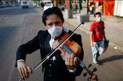 Mariachi player Gabriel Navarro plays his violin on April 28 in Mexico City.