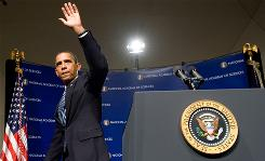 President Obama waves after speaking to the National Academy of Sciences annual meeting in Washington on Monday.