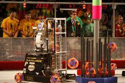 High school teams and their robots compete during the regional FIRST Robotics competition at San Diego Sports Arena in March.