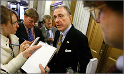 Sen. Arlen Specter, R-Pa., talking with reporters at the Capitol in Washington on Feb. 13, announced he is switching to the Democratic Party.