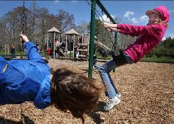 Snow Hill, Md., sixth-graders Annabelle Brady, 11, left, and Monica Vogel, 12, enjoy a school barbecue at a local park -- the longest trip students are taking in many districts.