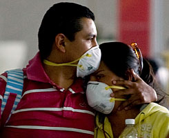 A couple travels through Mexico City's international airport on Wednesday.