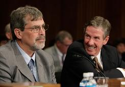 Capt. Richard Phillips, left, master of the MV Maersk Alabama, left, and John Clancey, right, chairman of Maersk, Inc. appear before a Senate Foreign Relations Committee hearing on Capitol Hill Thursday in Washington, DC. The committee is hearing testimony on recent attacks by pirates off the coast of Somalia.