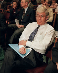 Former vice presidential candidate Jack Kemp waits to testify on Capitol Hill in 1997.