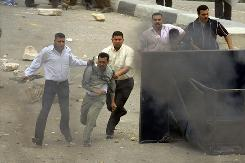 Plainclothes police officers detain farmers demonstrating against their pigs being slaughtered in a nationwide swine flu ruling in al-Mukatam neighbourhood in Cairo, Egypt, on May 3. Many of the demonstrating farmers are young Christians.