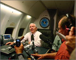 Defense Secretary Robert Gates speaks to reporters Sunday from on board a plane traveling from Andrews Air Force Base in Maryland to Cairo.