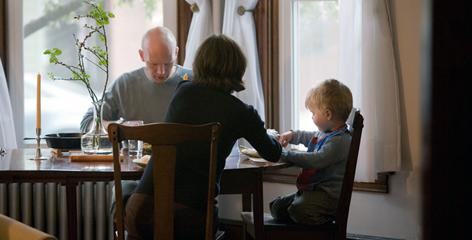 "Silas Dent Zobal, his wife Catherine Zobal Dent and their son Emerson Dent Zobal, 3, sit down for a meal at home in Shippensburg, Pa. ""My mom strongly identified with the feminist movement,"" Silas says, which is why he easily identifies with equal parenting."