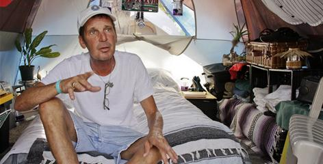 Kevin Shutt, 53, moved into a tent city near St. Petersburg, Fla.,in March. He was laid off from his job waiting tables and then was kicked out of his apartment.
