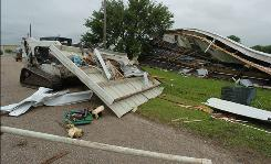 Debris is strewn about the rural community of Catahoula, La., after a tornado Monday.