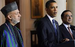 President Obama, center, addresses reporters with Afghanistan's President Hamid Karzai, left, and Pakistan's President Asif Ali Zardari, right, at the White House on Wednesday in Washington. Obama says he got the commitments he wanted from the leaders to more aggressively fight Taliban militants.