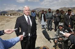 Secretary of Defense Robert Gates listens to a question from a reporter during his visit to Forward Operating Base Airborne  in the mountains of Wardak Province on Friday in Afghanistan. Gates is in Afghanistan ahead of the 21,000 increase in U.S. troops in the country.