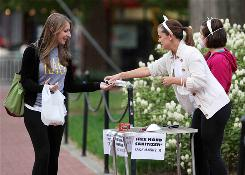 "University of Delaware seniors Allie Franklin (white jacket) and Ashley Manion give Jessica Smerling some free hand sanitizer as they shout: ""Don't whine, stop the swine"" on the Newark, Del., campus where student cases were confirmed. WHO has warned the southern hemisphere, which is entering its winter season, to take precautions as swine flu could worsen. Experts also say the swine flu could hit the U.S. again in our fall and winter."