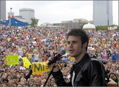 American Idol finalist and Conway, Ark., resident, Kris Allen,  speaks to a crowd of fans during his performance Friday in Little Rock, Ark.