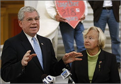 Rhode Island Gov. Don Carcieri, with wife Suzanne, speaks about gay marriage during a news conference for the National Organization for Marriage at the Rhode Island State House in Providence on April 8.
