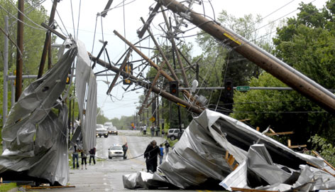 The roof of an apartment complex ripped off and downed power lines Friday in Carbondale, Ill.