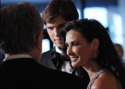 Ashton Kutcher and Demi Moore chat with CNN news anchor Wolf Blitzer at the 2009 White House Correspondents' Association Dinner on Saturday.