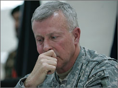 The Pentagon is replacing Gen. David McKiernan, top commander of U.S. and NATO forces in Afghanistan, with Lt. Gen. Stanley McChrystal, government sources say. Here, McKiernan is seen listening to a question from a journalist in Kabul, Afghanistan, on April 19.