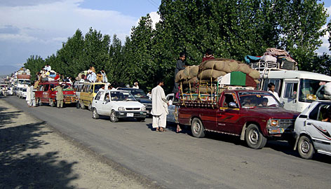 Local residents flee from Mingora, the main town of Pakistan's troubled Swat Valley, on Sunday.