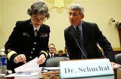 Anne Schuchat, left, interim CDC deputy director for science and public health, discusses with Anthony Fauci, director of the National Institute of Allergies and Infectious Diseases, at a hearing on H1N1 before the House Africa and Global Health Subcommittee in Washington May 6.