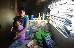 Nakeva Narcisse and daughter Asanta Mackey, 5, sit in their FEMA trailer in Port Sulphur, La., last May. Asanta has a persistent cough. Doctors fear tens of thousands of children were exposed to dangerous levels of the cancer-causing formaldehyde in the post-Katrina FEMA trailers.