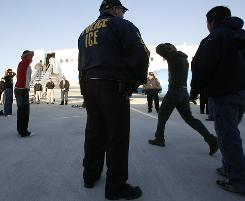 Salvadoran deportees head to a U.S. Immigration and Customs Enforcement agency plane in Harlingen, Texas, last year. Deportations of illegal immigrants rose 400% from 2002 to 2008, federal data show.