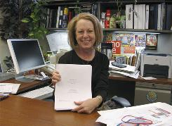 "Lee Doyle, director of the University of Michigan's film office, holds a copy of the script for the upcoming film ""Betty Anne Waters,"" in her Ann Arbor, Mich. office. Some of the movie was filmed at the university. College tie-ins allow TV shows and films to be more authentic while providing universities with free advertising."