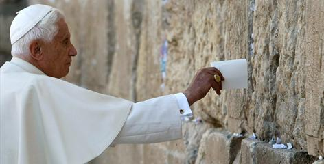 Pope Benedict XVI puts a note in the Western Wall, Judaism's holiest prayer site, in Jerusalem on Tuesday.