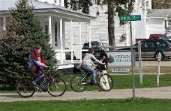 Students cross the small campus at Sterling College in Craftsbury Commons, Vt. School officials have asked for a $350,000 for a new dorm that it hopes will attract the minimum of 115 students it needs to survive.