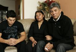 Sgt. Christian Bueno-Galdos' father Carlos Bueno, right, mother Eugenia Galdos and brother, Carlos Jr., at their home in Paterson, N.J., discuss the soldier's death Wednesday. Bueno-Galdos was one of five servicemembers killed in a mental health clinic in Baghdad.