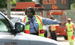 "Sgt. Donna Allen of the D.C. Metropolitan Police Department directs a driver into a ""Click it or Ticket"" checkpoint for not wearing a seat belt while driving in Washington."