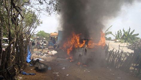 An ambulance burns outside a makeshift hospital Wednesday in Mullivaikal, Sri Lanka.