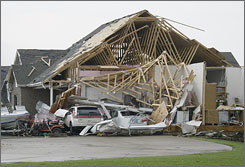 Three people died after tornadoes ripped through Missouri. Here, a badly damaged garage to a home is shown in Kirksville, Mo., on Wednesday.