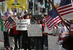 "Demonstrators protest against higher taxes in Santa Monica, Calif., on April 15 as part of a national ""Tea Party"" revolt. Voters in California face ballot proposals Tuesday to increase taxes to cover the state budget."