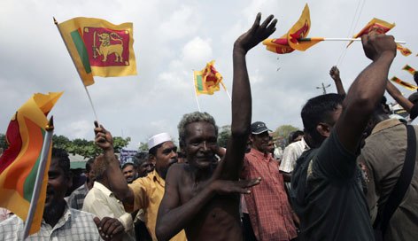 Sri Lankans celebrate in Colombo after President Mahinda Rajapaksa declared victory in the country's 25-year-civil war with separatist rebels Sunday.