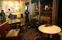 Following an earthquake in the South Bay of the Los Angeles area on Sunday employees at a Starbucks in Torrance, Calif., clean up glass that shattered on the floor and reportedly injured one person who was taken to a nearby hospital.