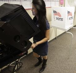 Dieutram Tran votes Tuesday in San Jose on a slew of measures intended to remedy the California's fiscal crisis.