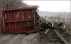 Several train cars transporting new motor vehicles lie on their sides after the train derailed along the McDade Expressway in Scranton, Pa., in March. Two train cars carrying hazardous materials were intact after one-fourth of a 43-car freight train derailed.