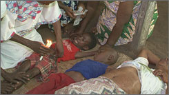 Pastor Moise Tshombe claims to remove evil spirits from children, pouring hot candle wax on a girl's belly.