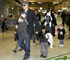 "At the Narita, Japan, airport, Brad Pitt carries son Knox Leon and holds the hand of Zahara as Pax walks beside him, left. Angelina Jolie carries Knox's twin Vivienne Marcheline and holds the hands of Maddox and Shiloh, right. ""It seems they've got some kind of fixation with always having an 'X' in the boy's name,"" Whitney Walker of ThePerfectBabyName.com told USA TODAY. ""It used to be people named their kids with the same first letter; people frown on that now as a little too cliche. But she wants them to have something in common. And 'X' is unusual, it stands out."""