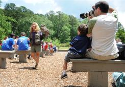 Ritchie White, right, and his son, Eli, enjoy Callaway Gardens' raptor bird show in Pine Mountain, Ga. The vacation site is just a drive away for the White family.