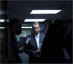 House Republican Leader John Boehner of Ohio is leading a delegation of GOP lawmakers calling for the creation of a bipartisan panel that would investigate allegations by House Speaker Nancy Pelosi that that the CIA misled her on its use of waterboarding. Here, Boehner is seen waiting for a news briefing on Capitol Hill on Thursday in Washington.